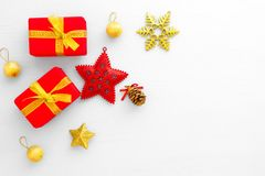 Red gift boxes, star, gold ball, pine cone and snowflake on white background. royalty free stock images