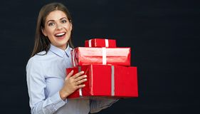 Red gift boxes toothy smiling business woman holding. Royalty Free Stock Photo