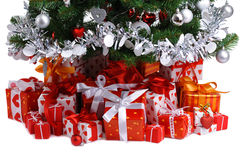 Red gift boxes under Christmas tree Stock Photos