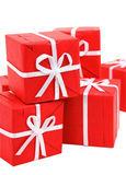 Red gift boxes on white background (clipping path included). Little red gift boxes isolated on white (clipping path included Stock Images