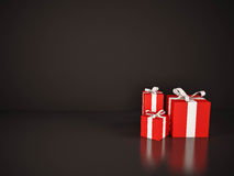 Red gift boxes with white ribbon on black background Stock Photos