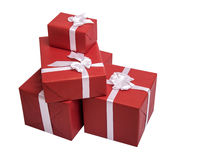 Red gift boxes with white ribbon. Isolated on white background Royalty Free Stock Photography