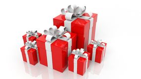 Red gift boxes with white ribbons. In various sizes isolated on white background Royalty Free Stock Images