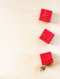 Red gift boxes on wooden textured background Stock Image