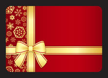 Red gift card with golden snowflakes and ribbon Stock Photo