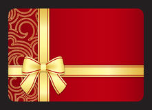 Red gift card with golden swirls and ribbon Royalty Free Stock Images