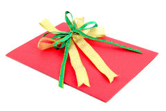 Red gift card with green and yellow bow. On white background Royalty Free Stock Photos