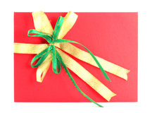 Red gift card with green and yellow bow Stock Photos