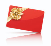 Red gift card. Vector illustration of red decorated gift card with golden ribbons and bow Stock Photos