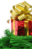 Red gift and christmas tree over white Royalty Free Stock Images