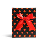 Red gift dotted box with ribbon Stock Image