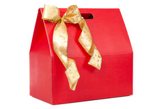 Red gift with gold bow Stock Photos