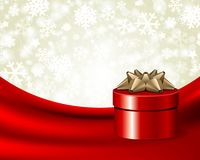 Red gift with gold bow on silk Stock Image
