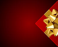 Red gift with gold bow top view Stock Photo