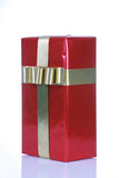 Red gift with gold ribbons Royalty Free Stock Photo