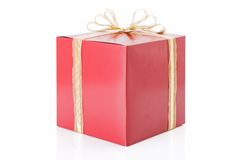 Red gift with a golden bow Royalty Free Stock Photos