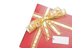 Red gift with a golden bow Royalty Free Stock Image