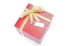 Red gift with a golden bow and tag Stock Images