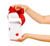 Red gift with hands Royalty Free Stock Photo
