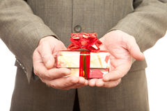 Red gift in hands Stock Images