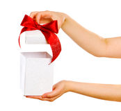 Red gift with hands Royalty Free Stock Photography