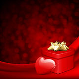 Red gift heart with heart on silk. Valentine's day background Stock Photo