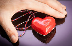 Red gift heart with reflection Royalty Free Stock Photos