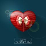 Red gift heart-shaped box with decorative bow Stock Photo