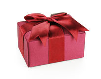Red Gift of Love. A small red gift box wrapped in ribbon, against a white background for easy extraction Stock Images