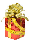 Red gift and measure tape Royalty Free Stock Photos