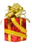Red gift and measure tape over white Royalty Free Stock Image