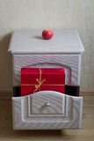 Red Gift in the nightstand. Photo serie with Red Gifts Stock Images