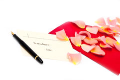 Red gift note envelope with pen next to it Stock Photos