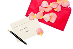 Red gift note envelope with pen next to it Royalty Free Stock Images