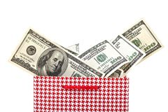 Red Gift package with american dollars isolated Royalty Free Stock Images