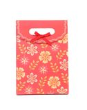 Red gift paper bag with flowers ptint. Royalty Free Stock Images