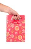 Red gift paper bag with flowers ptint. Stock Photo