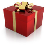 Red gift parcel with golden ribbon Royalty Free Stock Photography