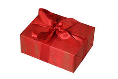 Red gift parcel. With red ribbon isolated on white background Royalty Free Stock Photo