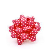 Red gift puff bow patterned with white dots Stock Photography