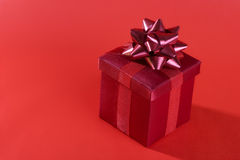 Red gift on red background Stock Photography