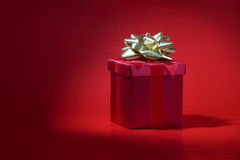 Red gift on red background Royalty Free Stock Image