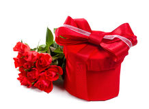 Red gift with a red bow and roses. Stock Images