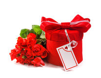 Red gift with a red bow and roses. Stock Photos