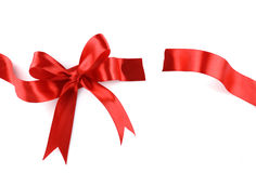 Red Gift Ribbon Bow. Cut into two parts  on White background Stock Photos