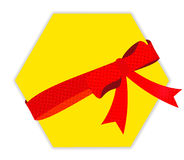 Red gift ribbon bow. On yellow card Stock Images