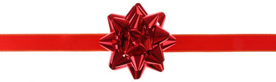 Red gift ribbon and bow. On a white background Stock Image