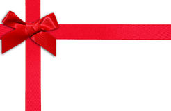 Red gift ribbon and bow. Red ribbon and gift bow white horizontal page Stock Photo
