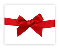 Red gift ribbon bow. Red gift satin bow and ribbon on a white card stock images
