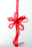 Red gift ribbon and bow. On white background Royalty Free Stock Photos